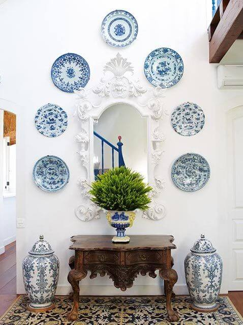 Blue and white plates in entry way
