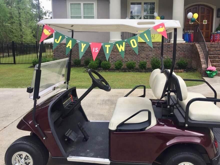 Birthday banner on golf cart
