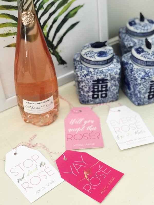 rosé wine gift tags scattered on table