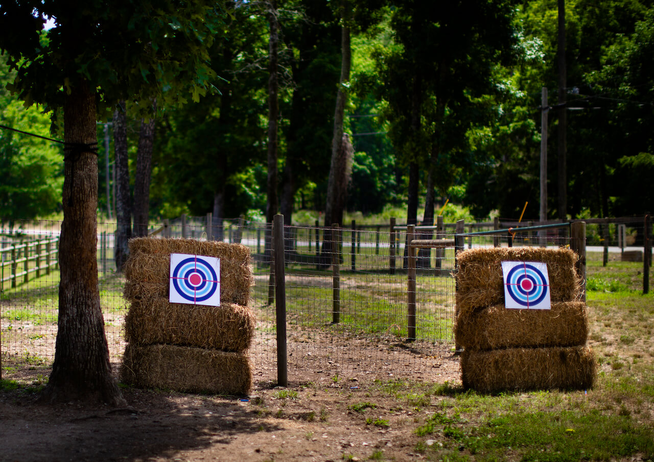 targets at camping birthday on hay bales