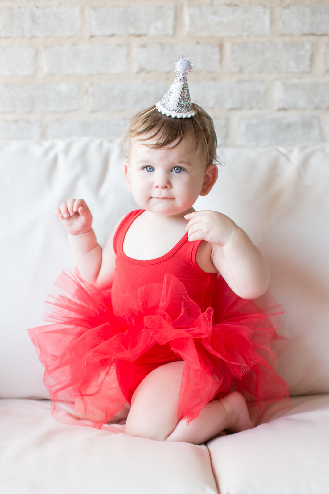 birthday girl in red tutu and party hat