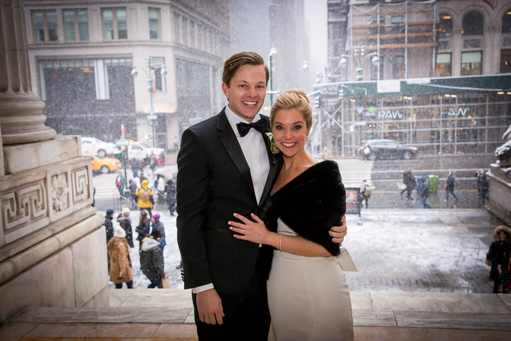 NYC bride and groom outside on church steps