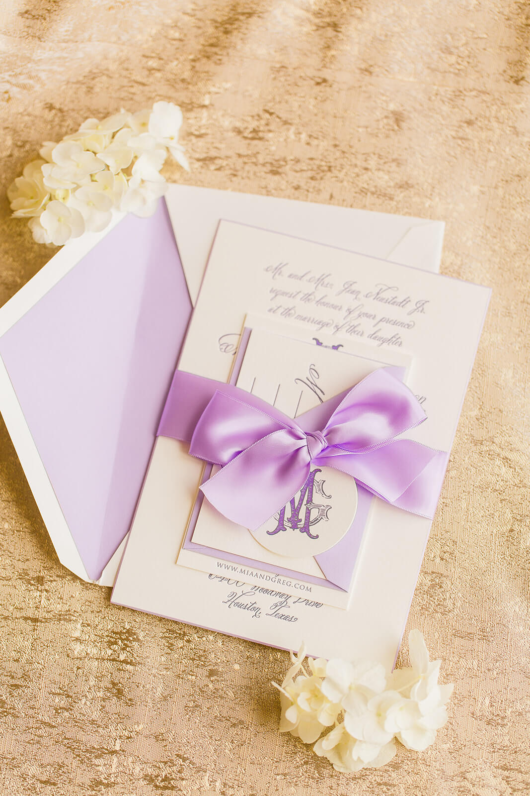 Lovely lavender letterpress wedding invitation with bow