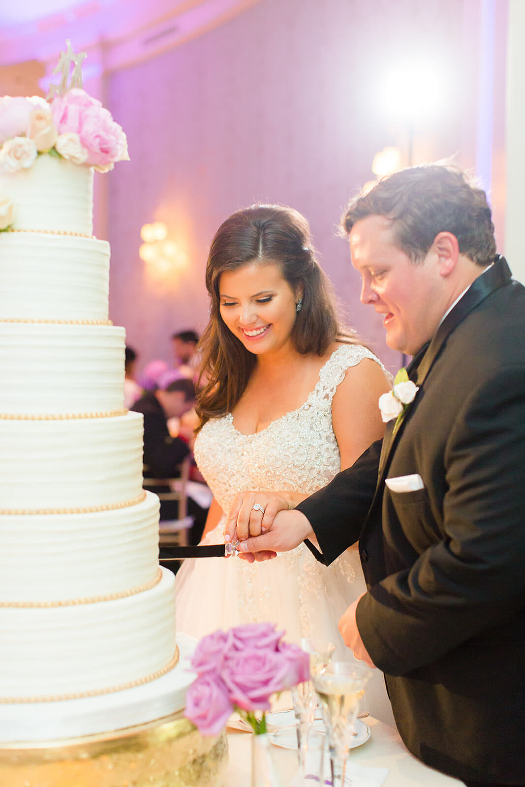 Houston couple cutting wedding cake