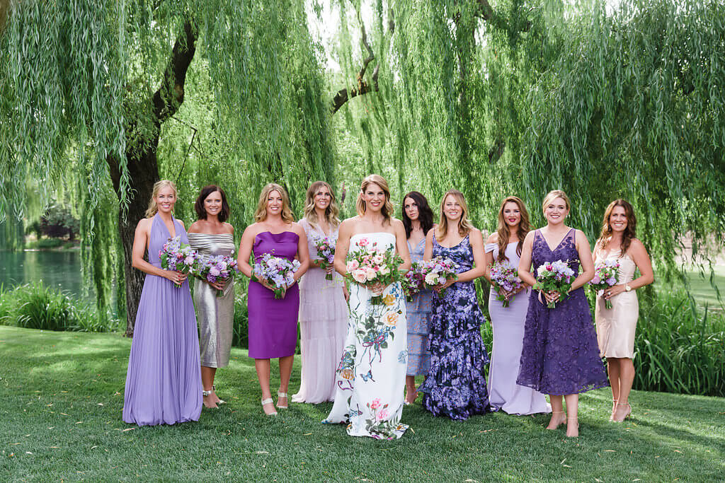 floral wedding dress with bridesmaids in lavender