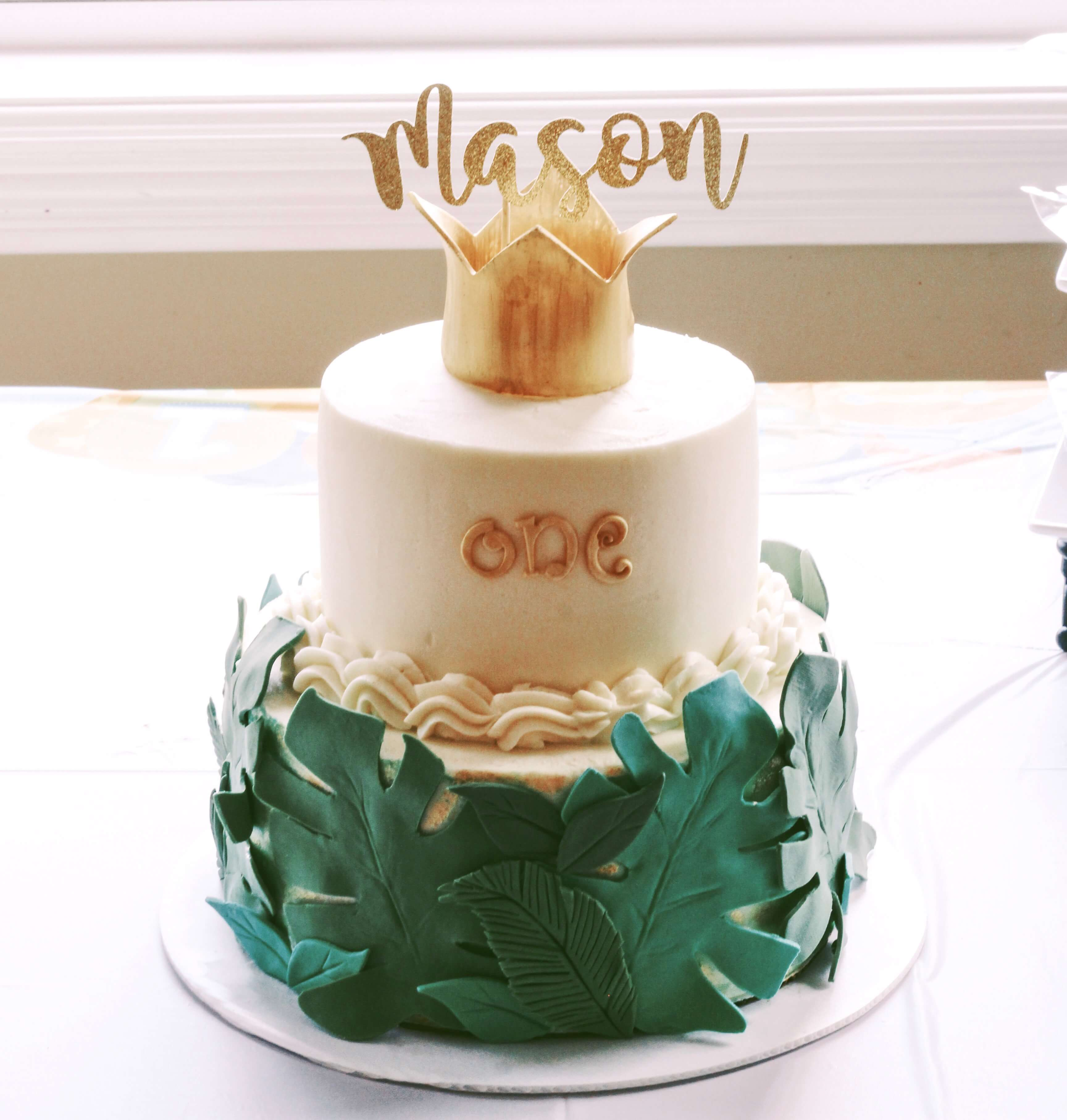 Palm leaf first birthday cake